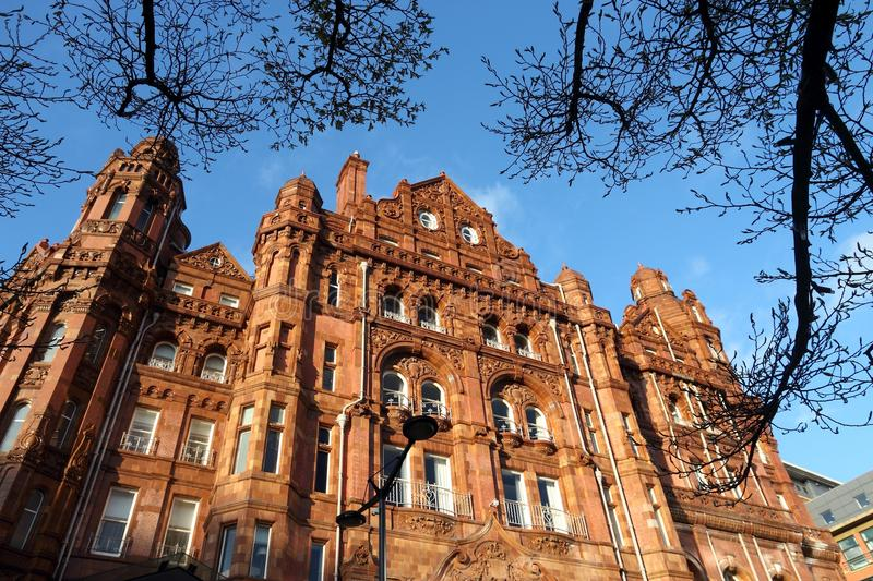 Manchester, UK. Manchester - city in North West England (UK). Famous hotel built in eclectic Edwardian baroque architecture style. Listed building royalty free stock images