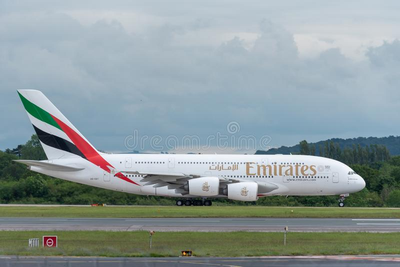 MANCHESTER UK, 30 MAY 2019: Emirates Airbus A380 flight EK18 to Dubai begins rolling for takeoff on Runway 28L at Manchester stock photo