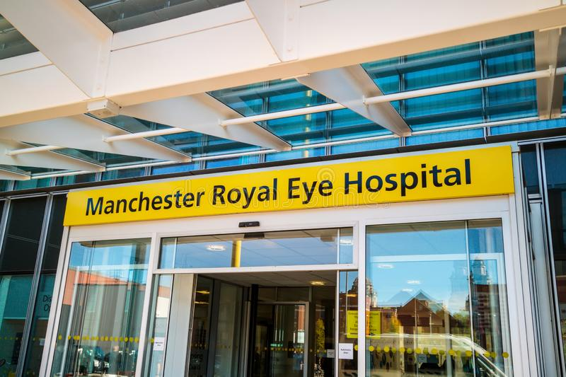 Modern building of an historic over 200 year old Manchester Royal Eye Hospital. MANCHESTER, UK - October 9, 2018: Manchester Royal Eye Hospital is part of a royalty free stock image