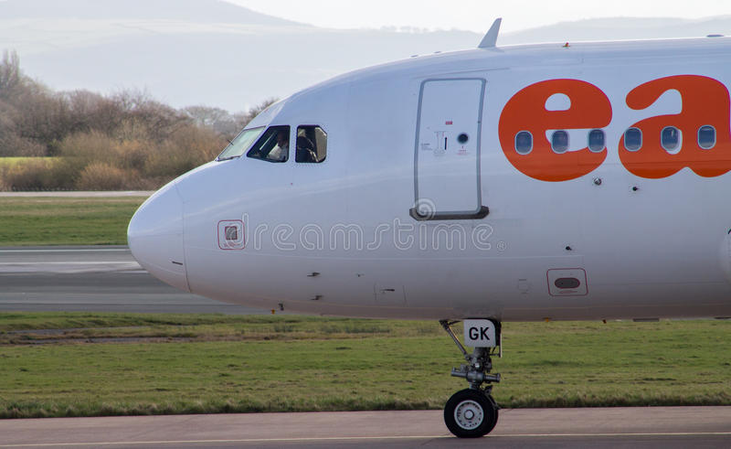 Manchester, United Kingdom - February 16, 2014: easyJet Airbus A. 319 arrives to Manchester Airport, front profile royalty free stock photos