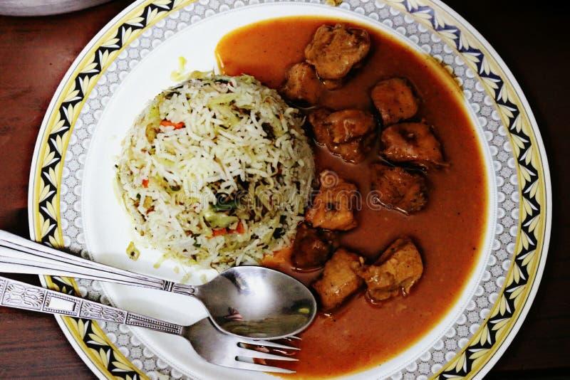Manchurian cinese con riso fotografia stock