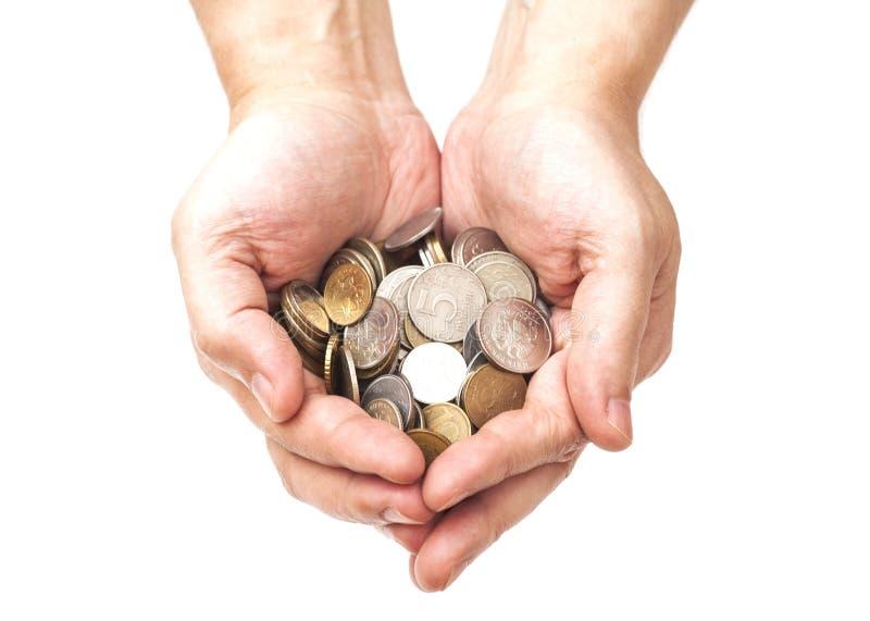 Manciata di monete in mani della palma fotografie stock libere da diritti