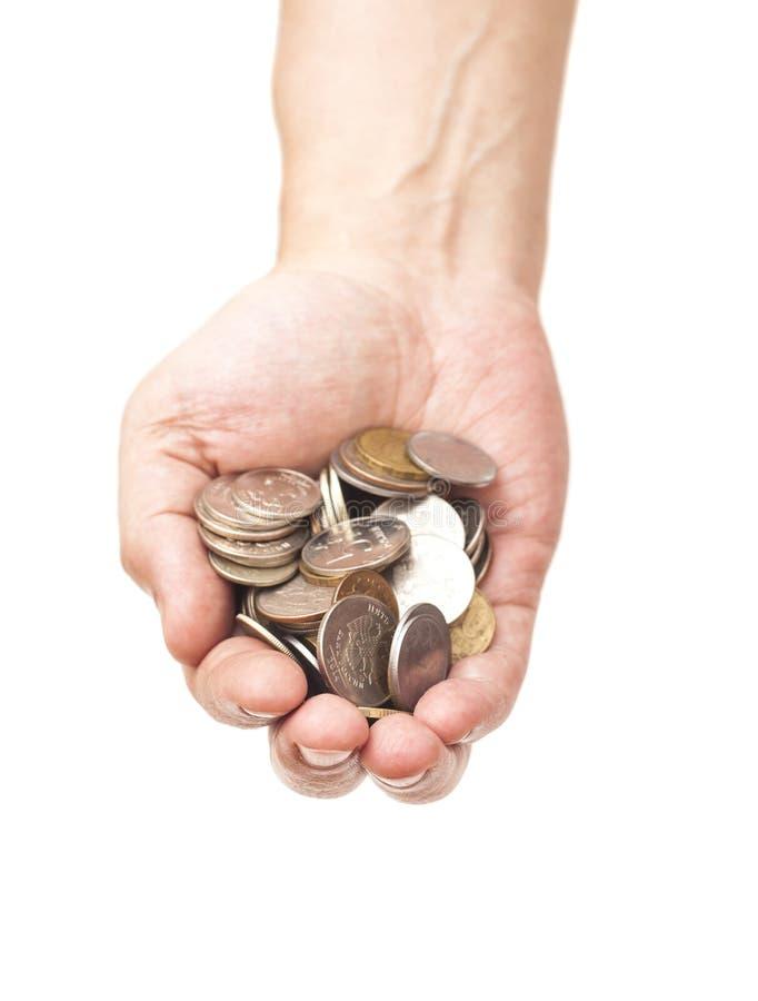 Manciata di monete in mano della palma fotografie stock