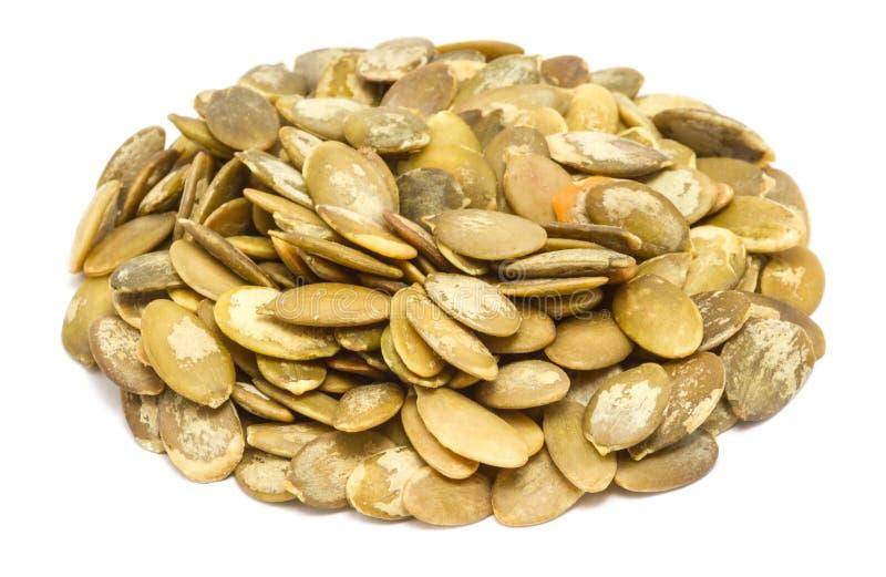 Manciata di semi di zucca senza coperture fotografie stock