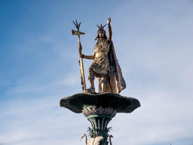 Manco Capac water fountain. Golden statue in Cusco, Peru stock images