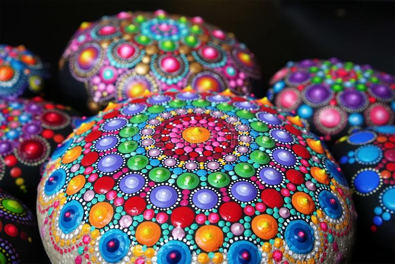 Mandala dot painting colorful stones stock photography