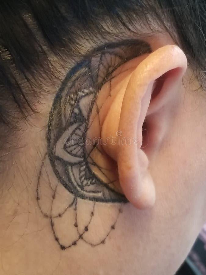 Mandala moon tattoo stock photos
