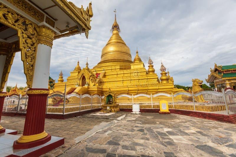 Kuthodaw Pagoda, golden yellow Buddhist religious structure in the Mandalay, Burma. Mandalay, Aungmyaythazan / Myanmar, Burma - July 24, 2019: Kuthodaw Pagoda stock photography