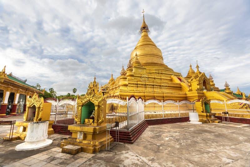 Kuthodaw Pagoda, golden yellow Buddhist religious structure in the Mandalay, Burma. Mandalay, Aungmyaythazan / Myanmar, Burma - July 24, 2019: Kuthodaw Pagoda stock image