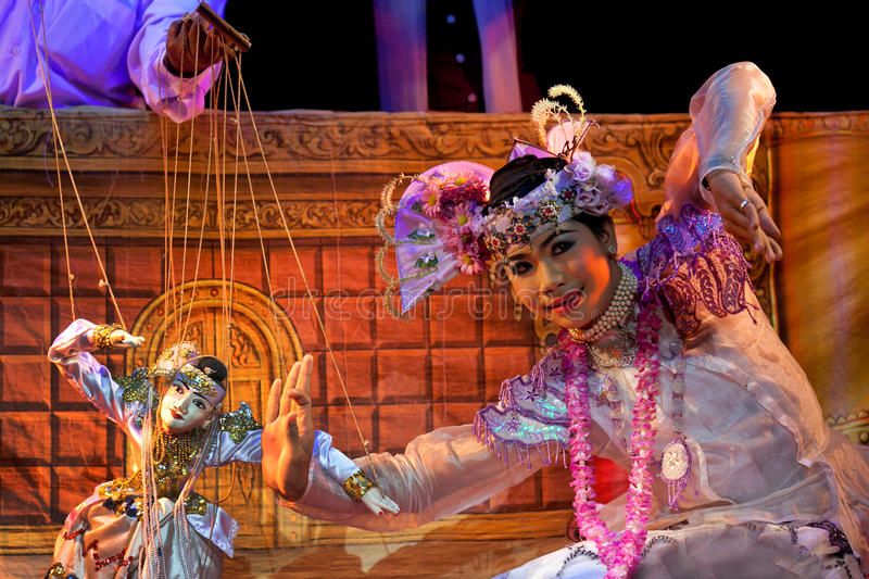 Mandalay Marionette Theatre. MANDALAY, MYANMAR - JANUARY 10: Girl actor performing during evening show at Mandalay Marionette Theatre on January 10, 2011 in royalty free stock image