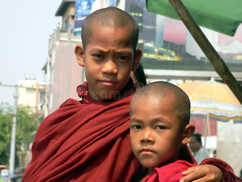 Mandalay, Myanmar. 2 Young Monks. Two young monks, one mentoring the other, which is common practice in Burma royalty free stock photography