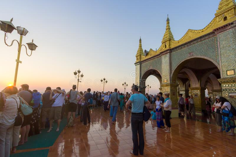 Crowds of tourist at Su Taung Pyae Pagoda. Mandalay, Myanmar - Feb 17,2018 : Crowds of tourist waiting to see sunset at Su Taung Pyae Pagoda on Mandalay Hills stock image