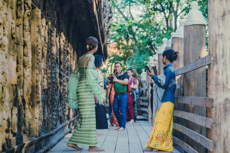 MANDALAY-Myanmar, January 19, 2019 : Unidentified tourists come to visit and take photographys at Shwe Nan Daw Kyaung Golden. Palace Monastery on january 19 stock image