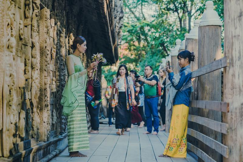 MANDALAY-Myanmar, January 19, 2019 : Unidentified tourists come to visit and take photographys at Shwe Nan Daw Kyaung Golden. Palace Monastery on january 19 royalty free stock images