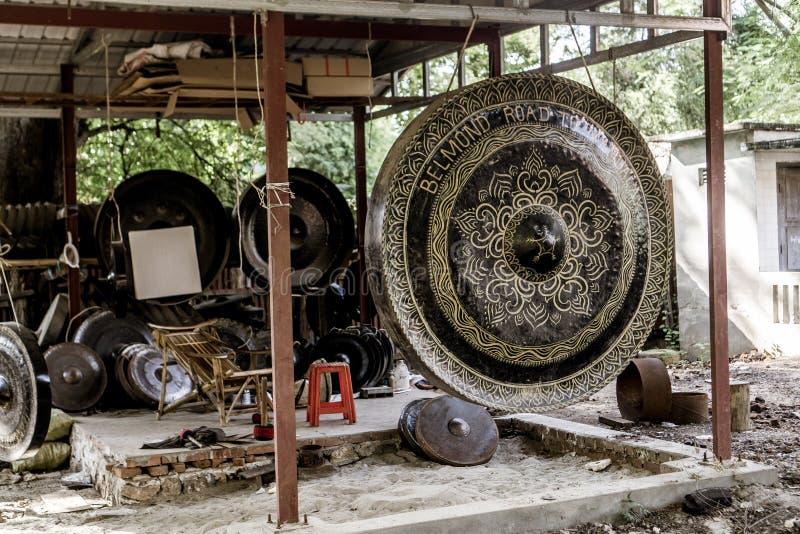 Mandalay, Myanmar. Large tin gongs at monastery royalty free stock photos