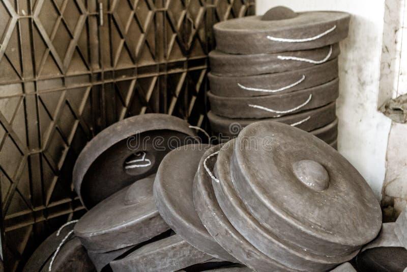 Mandalay, Myanmar. Pile of hand made gongs royalty free stock photo