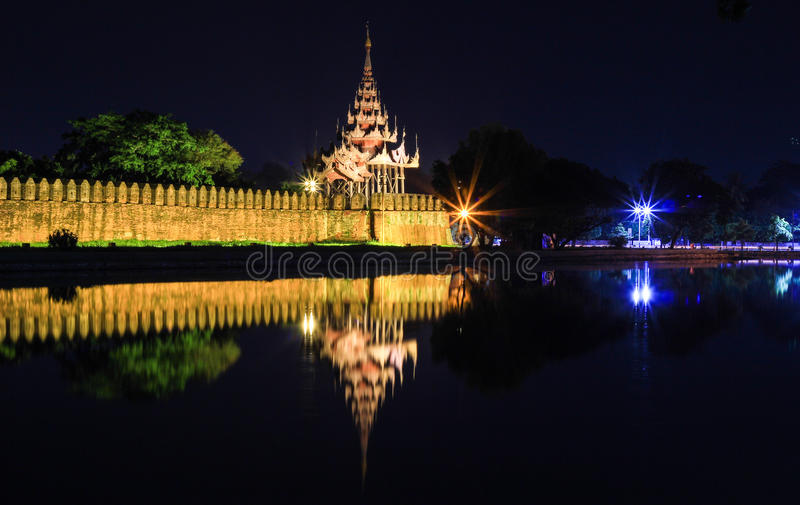 Mandalay Palace Moat and Wall at night. Mandalay Palace is locted in Mandalay,Myanmar.The whole palace complex was destroyed by fire during the Second World War stock photo
