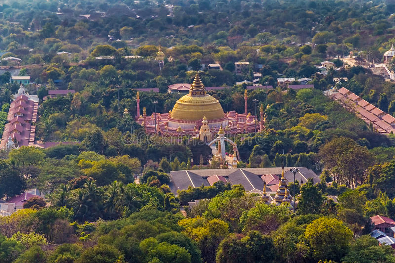 Mandalay. Panorama of the Mandalay city, a sanctuary and a lot of green trees, Myanmar royalty free stock images