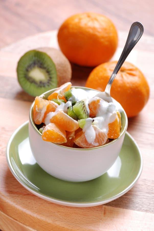 Mandarin and kiwi stock images