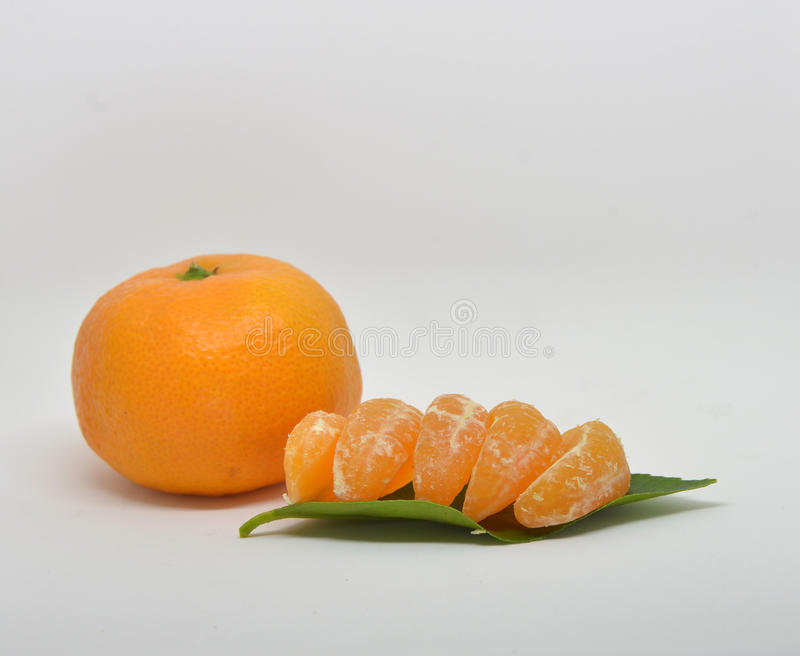 Mandarin with leaves close-up on a white royalty free stock image
