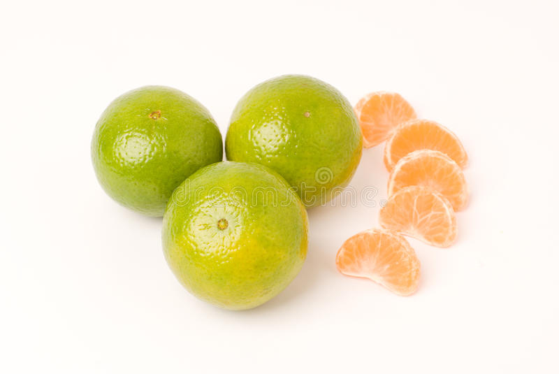Mandarin orange. Some segment of mandarin orange and three green mandarin orange royalty free stock photo