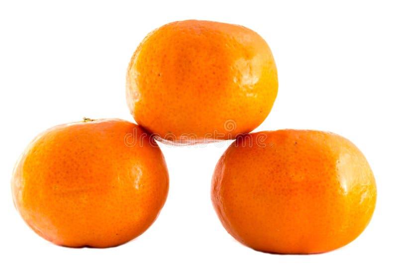 Mandarin and orange, close up with selective focus. royalty free stock photos