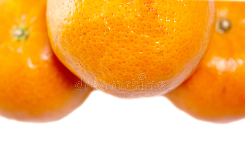 Mandarin and orange, close up with selective focus. royalty free stock image