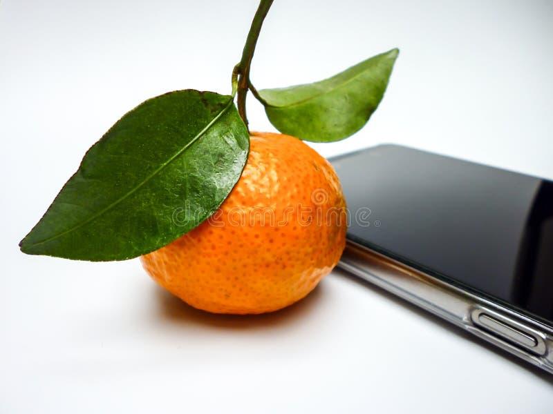 Mandarin orange and mobile phone royalty free stock photo