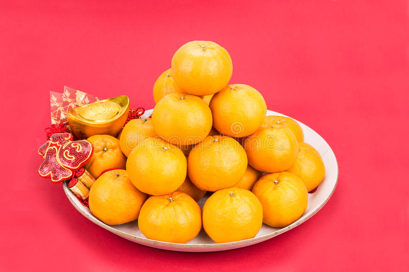 Mandarin oranges gold nuggets red packets chinese good luck w download mandarin oranges gold nuggets red packets chinese good luck w stock photo m4hsunfo Images