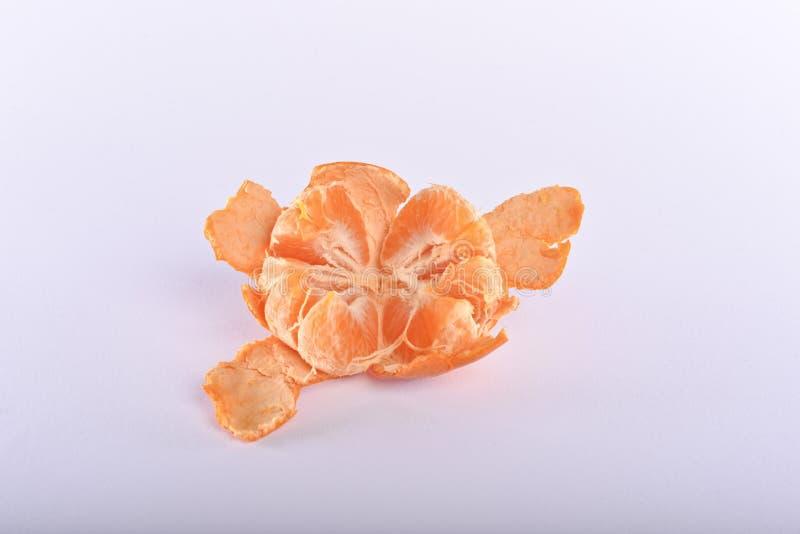 A mandarin peeled on a white background stock photos