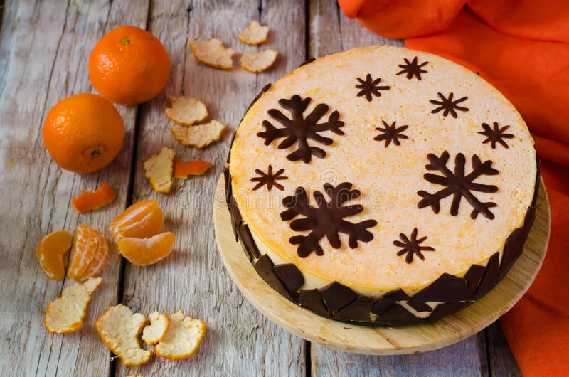 Mandarin souffle cake. With dark chocolate and tangerines on the bright white background stock photography