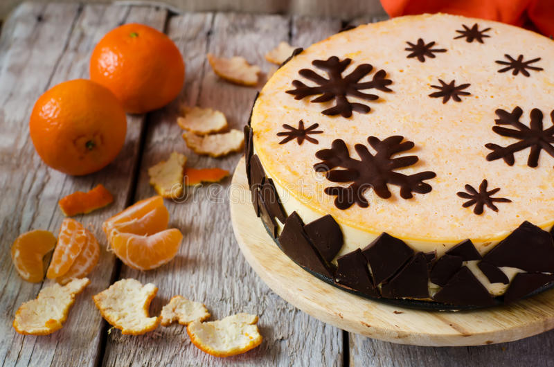 Mandarin souffle cake. With dark chocolate and tangerines on the bright white background stock photos