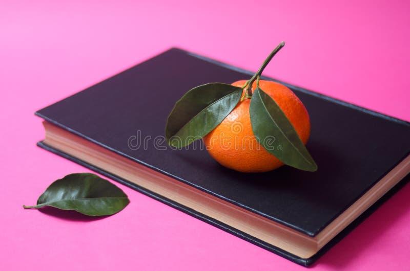 Download Mandarin stock image. Image of ripe, orange, white, book - 41222349