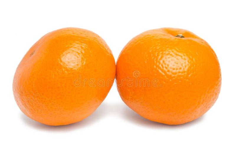 Mandarina jugosa fresca madura dos imagenes de archivo