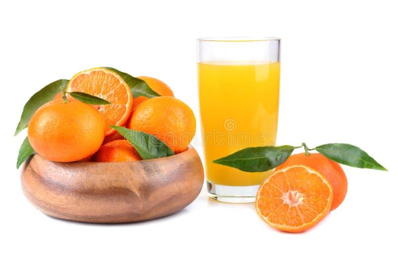 Mandarinas y jugo fotos de archivo