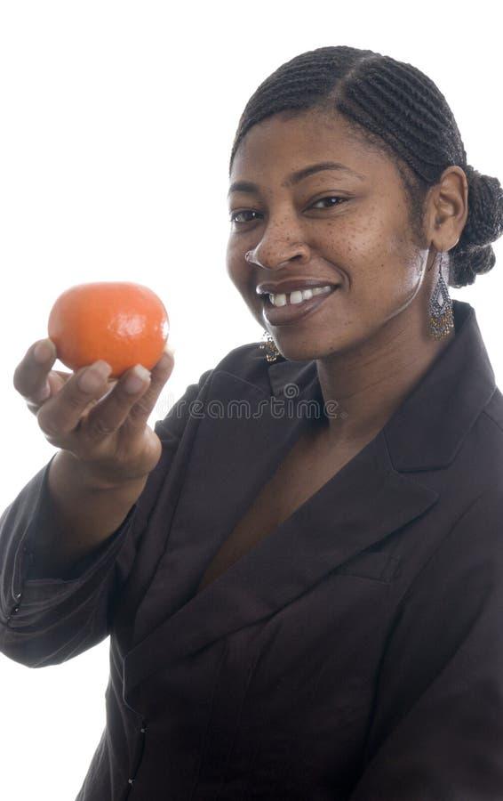 Mandarine de fixation de femme photographie stock libre de droits