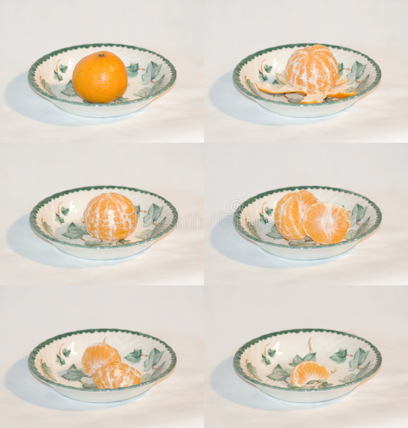 Mandarine, die gegessen wird lizenzfreie stockbilder