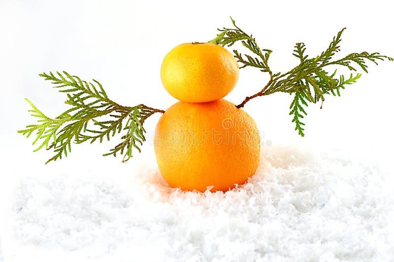 Mandarines como muñeco de nieve en la Navidad foto de archivo libre de regalías