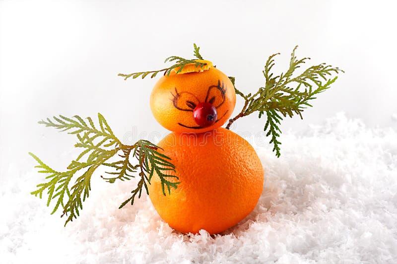 Mandarines como muñeco de nieve en la Navidad foto de archivo