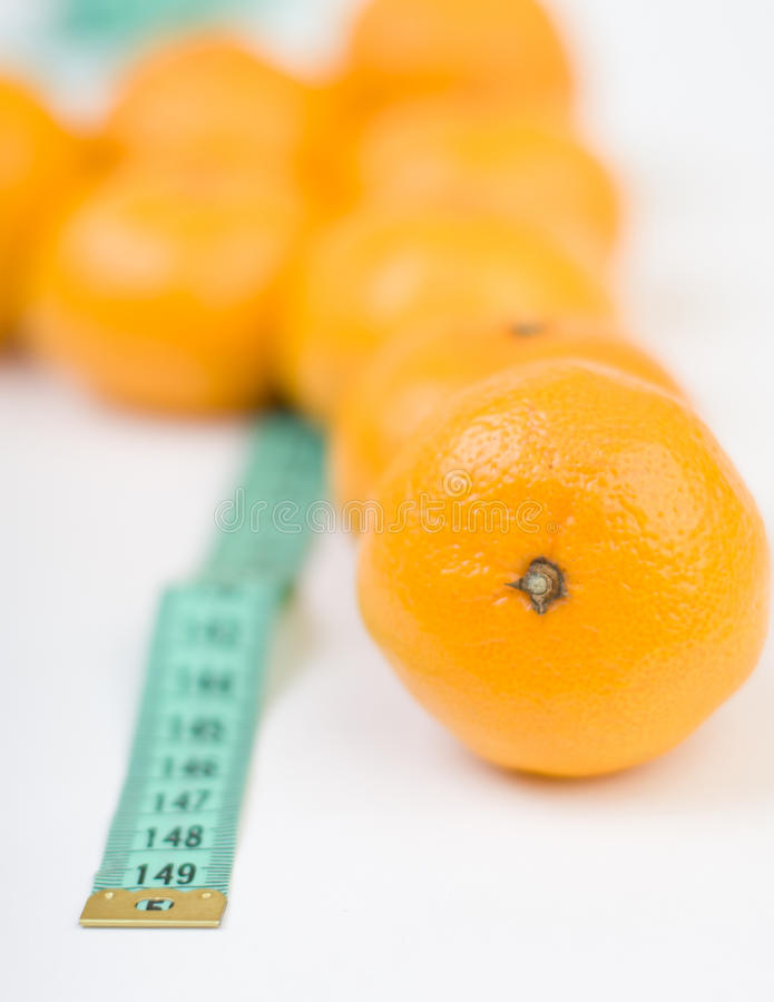 Mandarines et la ligne de mètre images stock