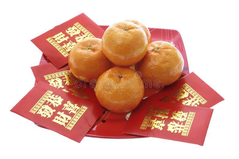 Mandarines et paquets chinois de rouge d'an neuf photographie stock libre de droits