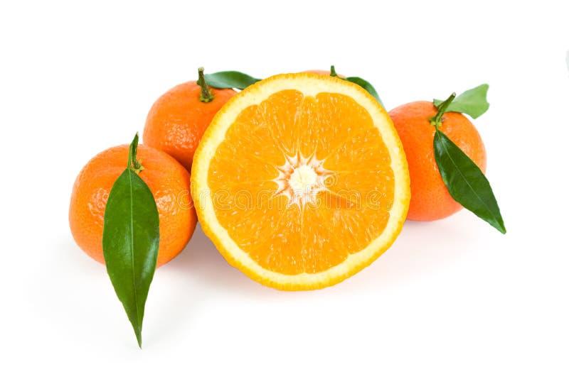 Mandarini e metà dell'arancio fotografia stock