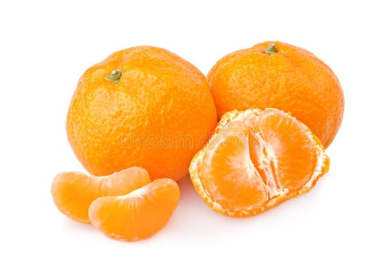 Mandarini maturi con le fette fotografia stock libera da diritti