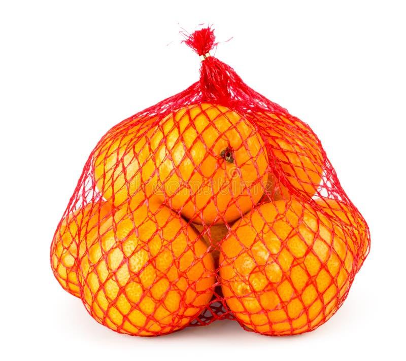 Mandarini maturi in primo piano di griglia su un bianco Isolato fotografia stock libera da diritti