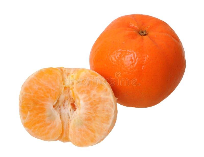 Mandarino sbucciato ed intero fotografia stock libera da diritti