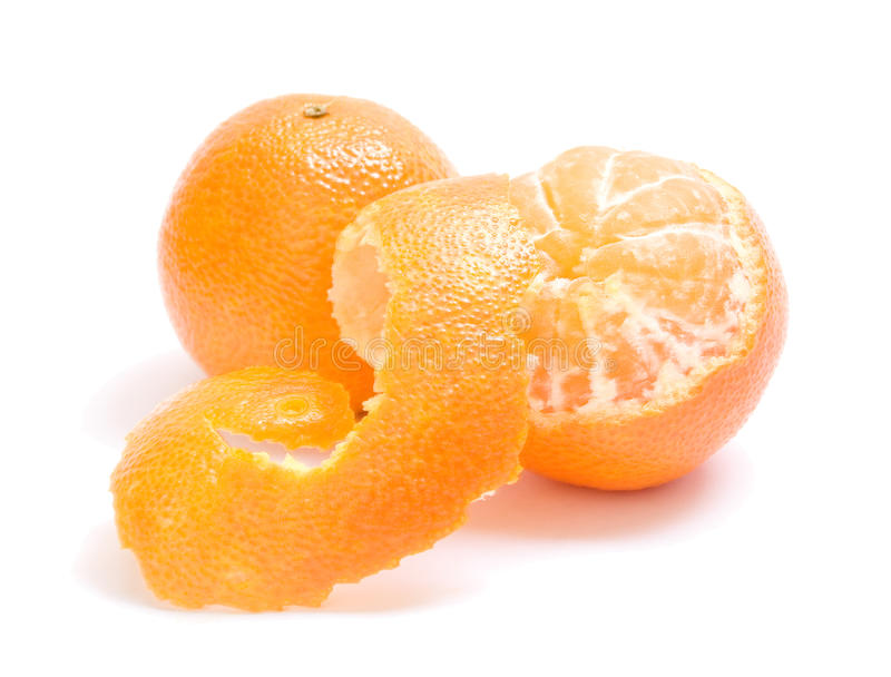 Mandarins. Two peeled mandarins on white background royalty free stock image