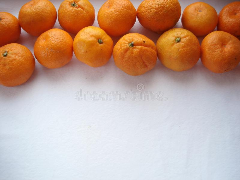 Mandarins in a row with a background, top view. stock photos