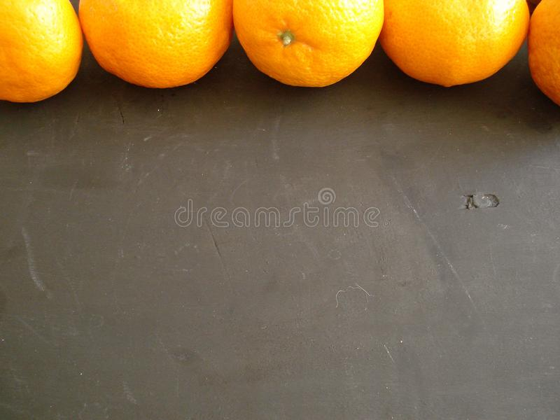 Mandarins at the top of the frame. stock photos