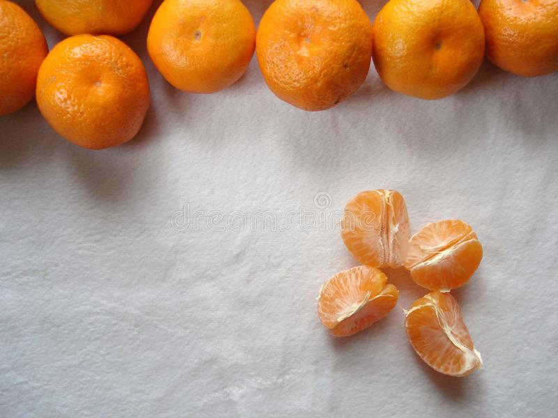 Mandarins on a white background. Purified mandarin. Slices of tangerine, top view. royalty free stock image