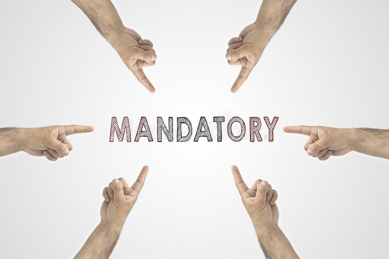 Mandatory concept. Hands around the photo showing to the inscription: Mandatory.  stock images